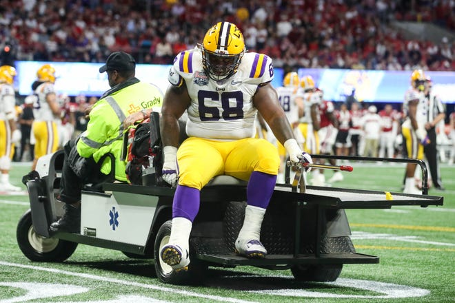 Dec 28, 2019; Atlanta, Georgia, USA; LSU Tigers guard Damien Lewis (68) is carted off the field during the first quarter of the 2019 Peach Bowl college football playoff semifinal game against the Oklahoma Sooners at Mercedes-Benz Stadium. Mandatory Credit: Jason Getz-USA TODAY Sports