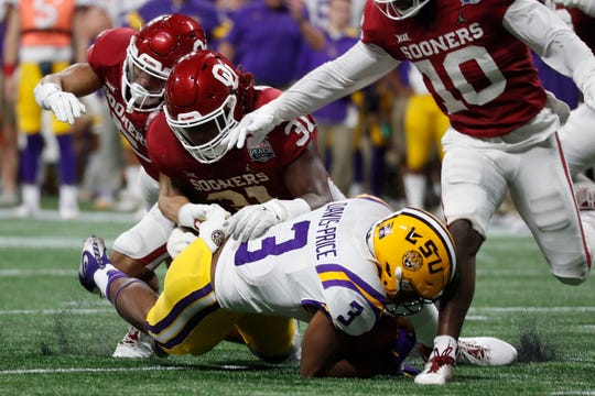 LSU running back Tyrion Davis-Price (3) scores a touchdown against Oklahoma during the first half of the Peach Bowl NCAA semifinal college football playoff game, Saturday, Dec. 28, 2019, in Atlanta. (AP Photo/John Bazemore)
