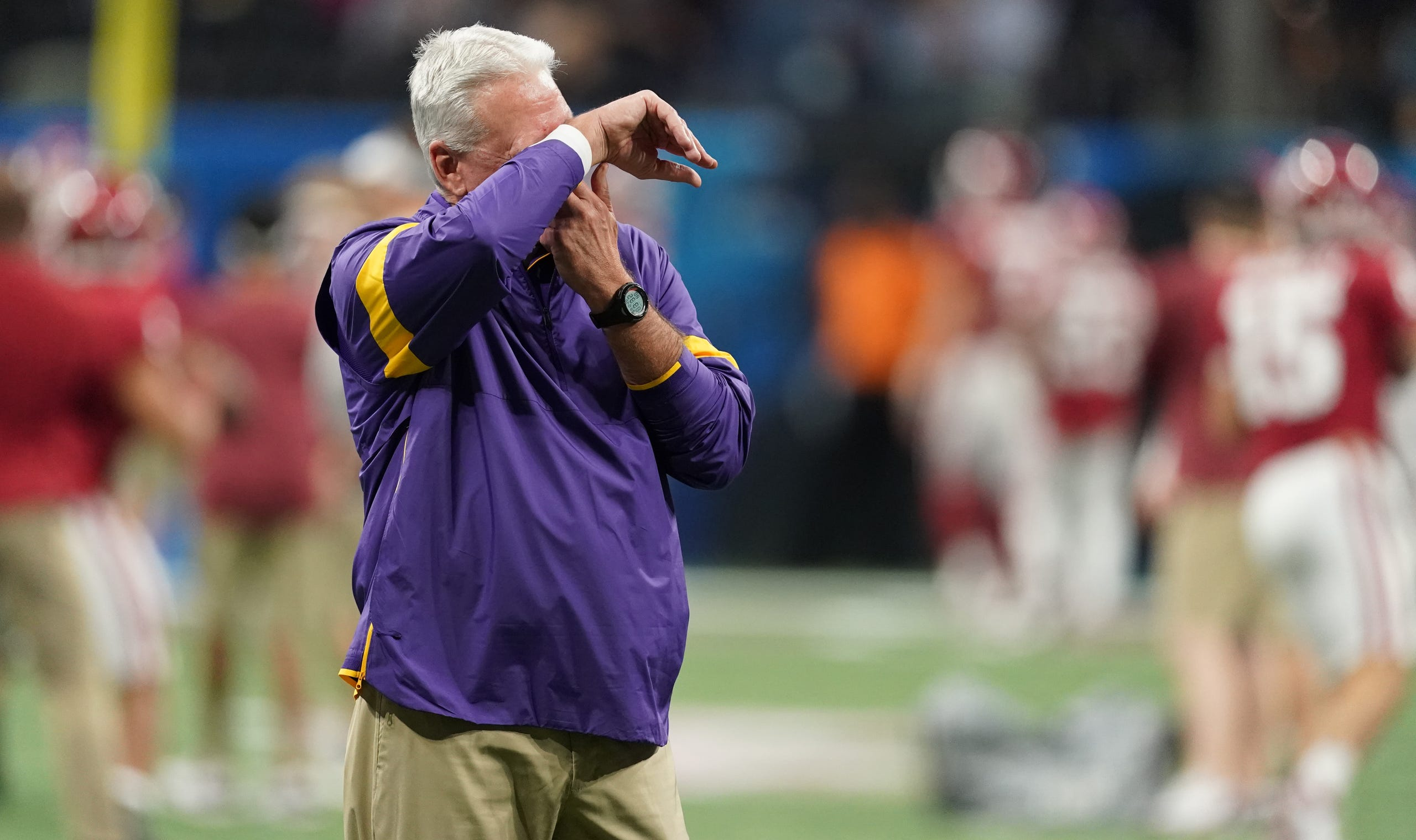 Dec 28, 2019; Atlanta, Georgia, USA; LSU Tigers offensive coordinator/quarterbacks coach Steve Ensminger reacts before the 2019 Peach Bowl college football playoff semifinal game against the Oklahoma Sooners. Mandatory Credit: John David Mercer-USA TODAY Sports
