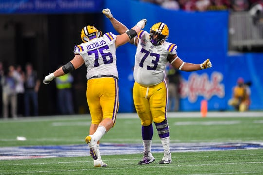 Dec 28, 2019; Atlanta, Georgia, USA; LSU Tigers offensive lineman Austin Deculus (76) and offensive lineman Adrian Magee (73) react during the first quarter of the 2019 Peach Bowl college football playoff semifinal game against the Oklahoma Sooners at Mercedes-Benz Stadium. Mandatory Credit: Dale Zanine-USA TODAY Sports