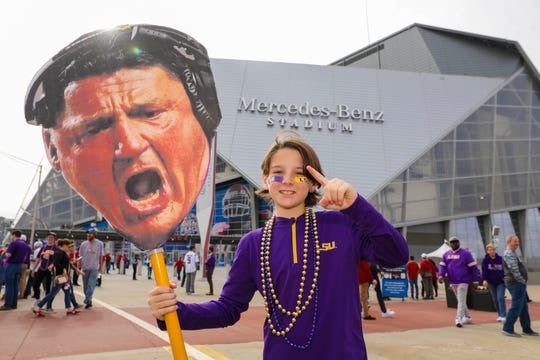 Dec 28, 2019; Atlanta, Georgia, USA; LSU Tigers fan Kevin Welch, 12, of  outside the stadium before the 2019 Peach Bowl college football playoff semifinal game between the LSU Tigers and the Oklahoma Sooners.