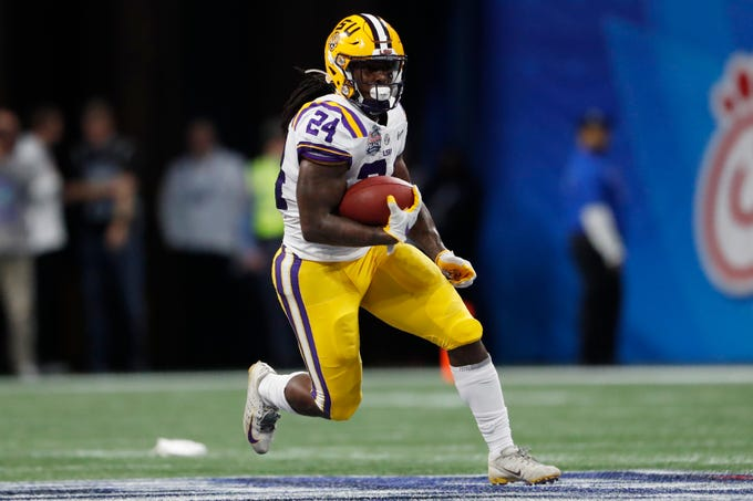 LSU running back Chris Curry (24) runs against Oklahoma during the first half of the Peach Bowl NCAA semifinal college football playoff game, Saturday, Dec. 28, 2019, in Atlanta. (AP Photo/John Bazemore)