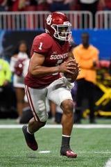 Oklahoma quarterback Jalen Hurts (1) runs against LSU during the first half of the Peach Bowl NCAA semifinal college football playoff game, Saturday, Dec. 28, 2019, in Atlanta. (AP Photo/Danny Karnik)