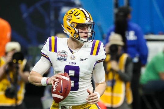 Dec 28, 2019; Atlanta, Georgia, USA; LSU Tigers quarterback Joe Burrow (9) with the ball during the first quarter of the 2019 Peach Bowl college football playoff semifinal game against the Oklahoma Sooners at Mercedes-Benz Stadium. Mandatory Credit: Jason Getz-USA TODAY Sports