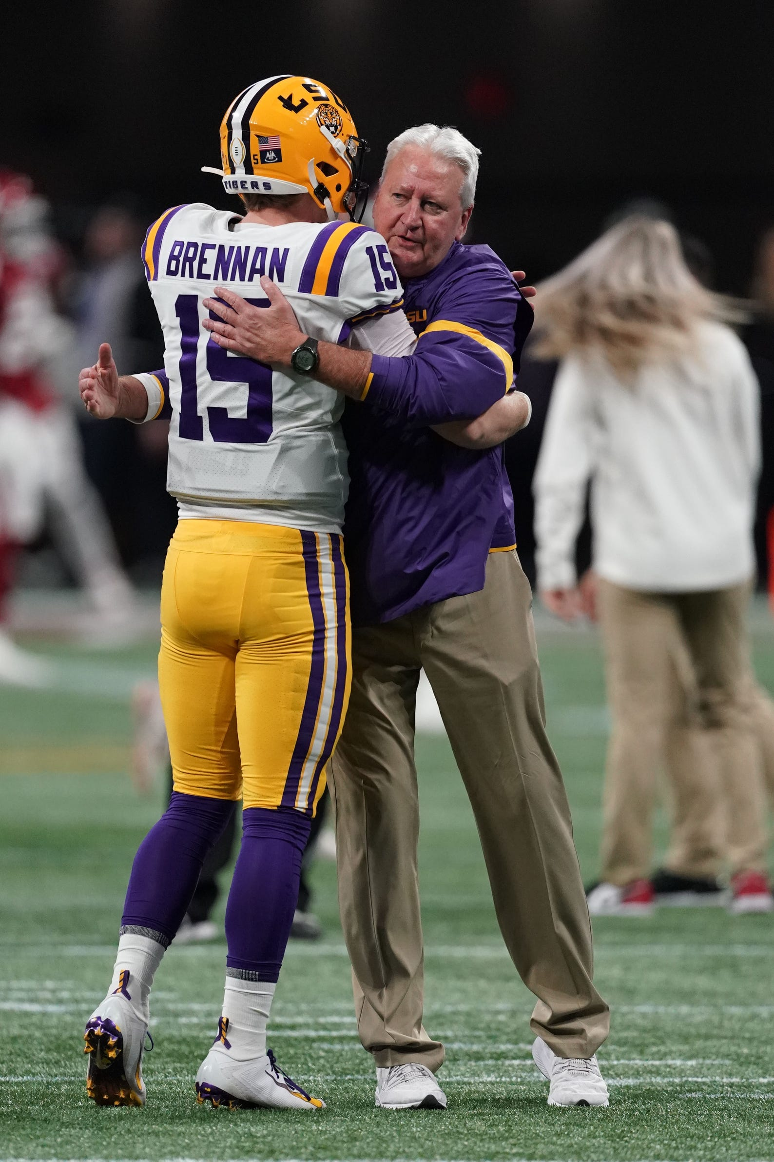 Dec 28, 2019; Atlanta, Georgia, USA; LSU Tigers offensive coordinator/quarterbacks coach Steve Ensminger reacts with quarterback Myles Brennan (15) before the 2019 Peach Bowl college football playoff semifinal game against the Oklahoma Sooners. Mandatory Credit: John David Mercer-USA TODAY Sports