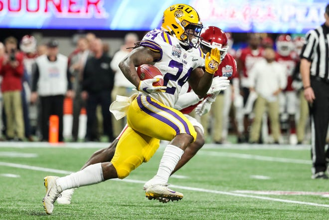 Dec 28, 2019; Atlanta, Georgia, USA; LSU Tigers running back Chris Curry (24) runs the ball during the first quarter of the 2019 Peach Bowl college football playoff semifinal game against the Oklahoma Sooners at Mercedes-Benz Stadium. Mandatory Credit: Jason Getz-USA TODAY Sports