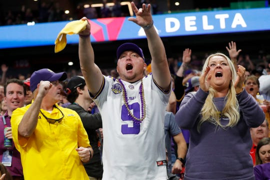 LSU fans cheer during the first half of the Peach Bowl NCAA semifinal college football playoff game between LSU and Oklahoma, Saturday, Dec. 28, 2019, in Atlanta. (AP Photo/John Bazemore)