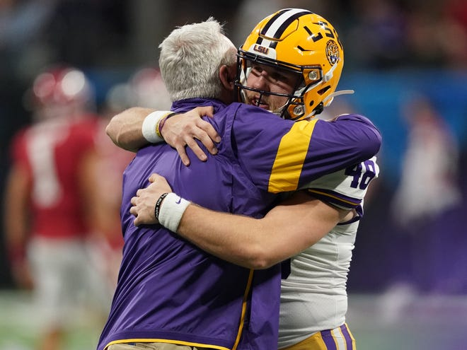 Dec 28, 2019; Atlanta, Georgia, USA; LSU Tigers offensive coordinator/quarterbacks coach Steve Ensminger reacts with long snapper Blake Ferguson (48) before the 2019 Peach Bowl college football playoff semifinal game against the Oklahoma Sooners. Mandatory Credit: John David Mercer-USA TODAY Sports