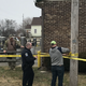 Police put tape around the area Saturday where a man took a Cristy's Pizza employee hostage at knifepoint before police shot and killed him. The woman was not injured and no one else was injured, Lancaster Police Department Deputy Chief Dan Shupp said.