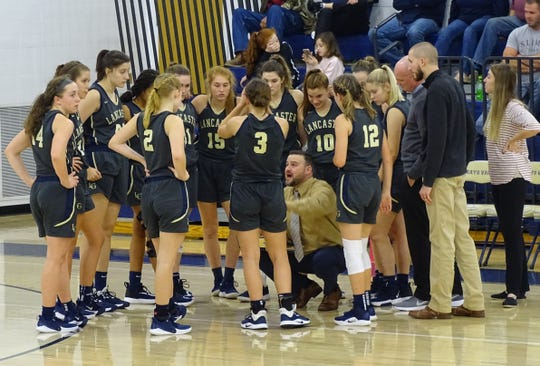 Lancaster girls' basketball coach dusty Miller talks with his team during a timeout in Friday's 56-53 overtime loss at Teays Valley.