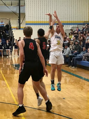 River Valley point guard Ethan Bell takes a jump shot in a game against Marion Harding this season. During this shutdown of sports due to the coronavirus outbreak, Bell is working on his speed and agility as well as basketball skills on his own time.