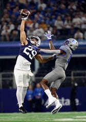 Penn State Nittany Lions cornerback John Reid (29) deflects the ball away from Memphis Tigers wide receiver Damonte Coxie (10) during the first quarter at AT&T Stadium.