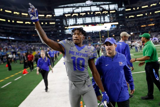 Memphis wide receiver Damonte Coxie points to the cheering crowds Saturday, Dec. 28, 2019, as we walks off the field after the Goodyear Cotton Bowl Classic at AT&T Stadium in Arlington, Texas. Memphis lost to Penn State 53-39.