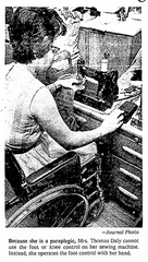 """An image of Ellen Daly from the Milwaukee Journal on May 3, 1970, depicts the disability rights advocate operating the foot pedal of her sewing machine with her hand. The photo ran with a story headlined """"Wife Handles Homemaking from Wheelchair."""""""
