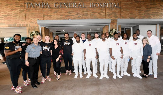 Minnesota and Auburn players take a picture before their visit to Tampa General Hospital on Friday, Dec. 26, 2019 in Tampa, FL.