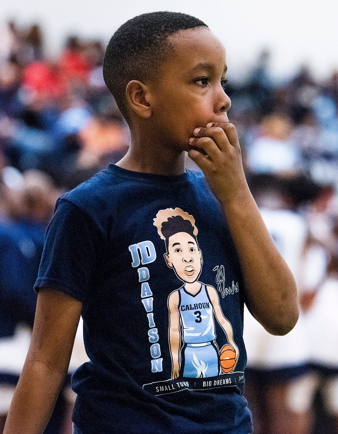 A young ballboy sports a J.D. Davison t-shirt during the Dwight Madison tournament on the Carver campus in Montgomery, Ala., on Friday December 27, 2019.