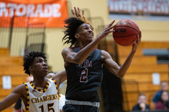 First Baptist Academy's Jamal Norris attempts a shot during their game against Hallandale during the Kelleher Firm Gulfshore Holiday Hoopfest, Saturday, Dec. 28, 2019, at Golden Gate High School.