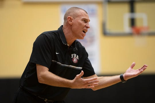 First Baptist Academy head coach Scott Stewart yells instructions to his team during their game against Hallandale during the Kelleher Firm Gulfshore Holiday Hoopfest, Saturday, Dec. 28, 2019, at Golden Gate High School.