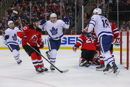 Dec 27, 2019; Newark, New Jersey, USA; Toronto Maple Leafs left wing Zach Hyman (11) celebrates after scoring a goal during the first period against the New Jersey Devils at Prudential Center.