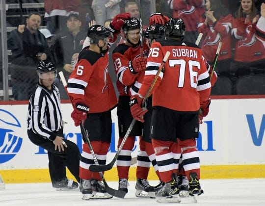 New Jersey Devils center Nico Hischier (13) celebrates his goal with teammates during the first period of an NHL hockey game against the Toronto Maple Leafs, Friday, Dec. 27, 2019, in Newark, N.J.