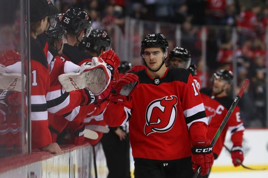 Dec 27, 2019; Newark, New Jersey, USA; New Jersey Devils center Nico Hischier (13) celebrates with teammates on the bench after scoring a goal during the first period against the Toronto Maple Leafs at Prudential Center.