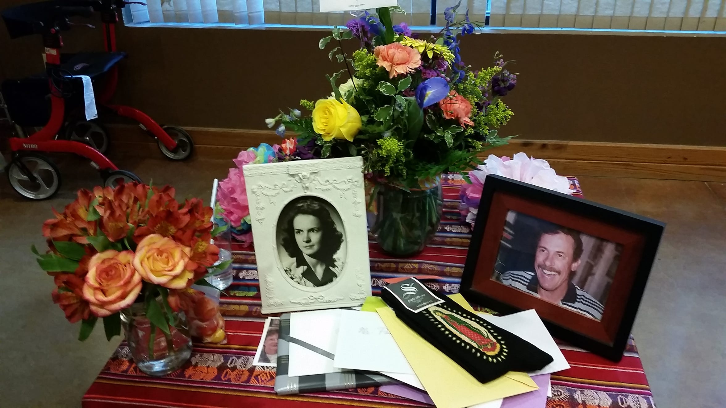 A memorial table is displayed in honor of the late Mary Helen Daniels Taylor and John Paul Taylor Jr. during J. Paul Taylor's 99th birthday celebration at the New Mexico Farm & Ranch Heritage Museum in August 2019.