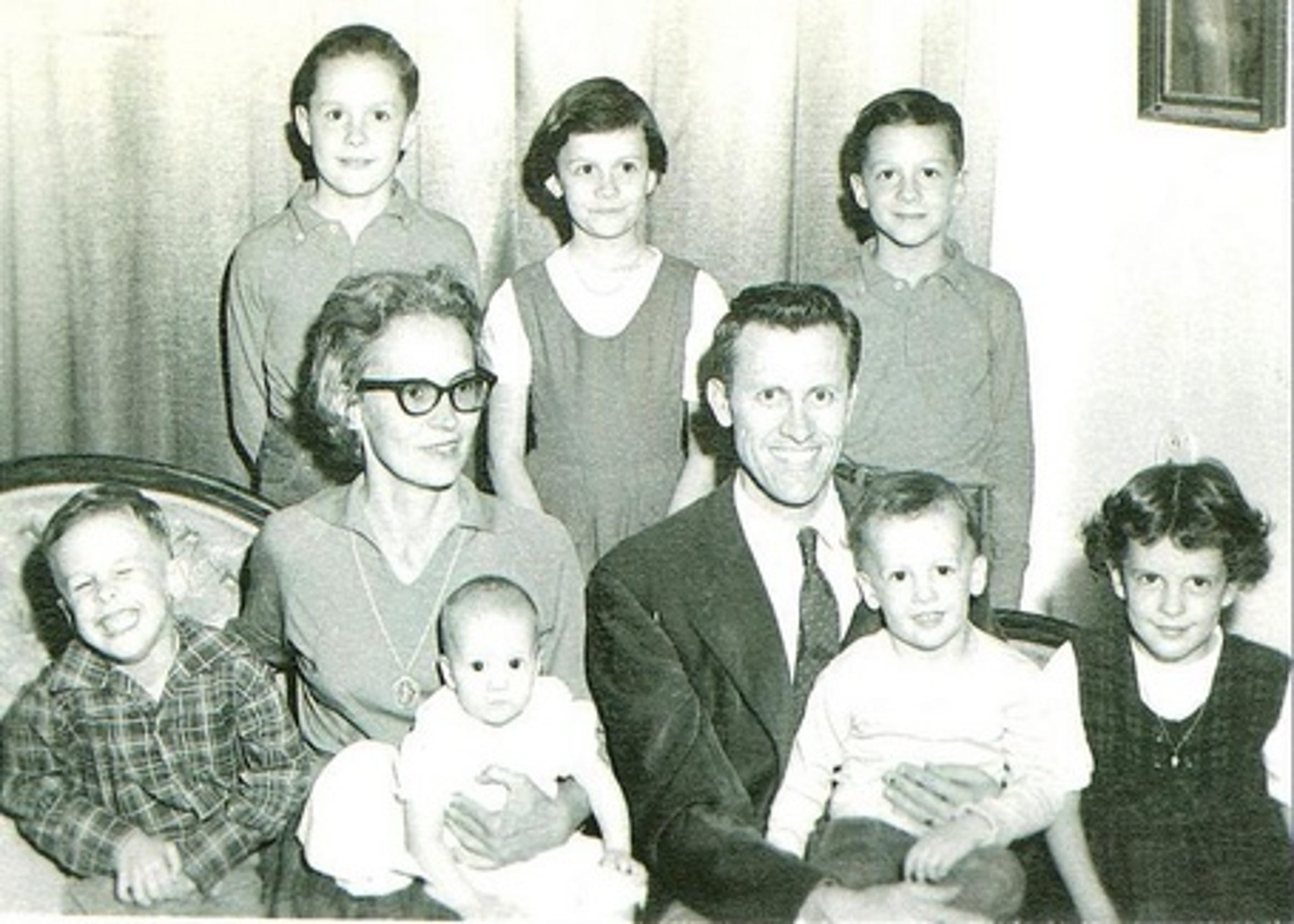 J. Paul and Mary Daniels Taylor with their seven children.