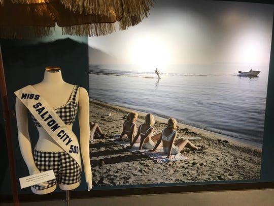 "A sash, swimsuit and enlarged photograph greet visitors at the La Quinta Museum's ""Salton Sea Stories"" exhibit."