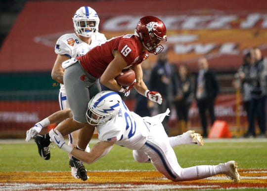 Air Force's Garrett Kauppila (22) tackles Washington State's Brandon Arconado (19) during the first half of the Cheez-It Bowl at Chase Field in Phoenix, Ariz. on Dec. 27, 2019.