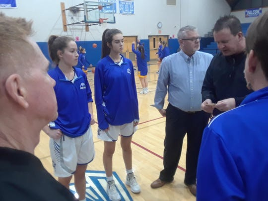 Cedar Crest players, from left, Elizabeth Knapp and Reese Glover and coach Jim Donmoyer meet with referee Will Wenninger and representatives from Waynesboro prior to Friday night's opening round game in the Lower Dauphin Holiday Tournament.