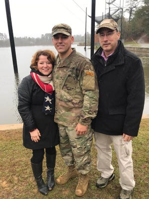 Mark Pyles, with mom Heidi, left, and father Peter, celebrated the ex-Lebanon High quarterback's graduation from Army Ranger School at Fort Benning, Ga. in November.