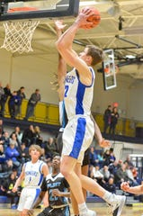 Croswell-Lexington's Hunter Soper attempts a layup against Flint Southwestern during a SC4 Showcase boys basketball game on Friday, Dec. 27, 2019, at SC4 Fieldhouse in Port Huron.