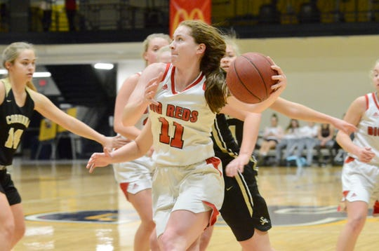 Port Huron's Emma Trombly dribbles to the basketball against Corunna during a SC4 Showcase girls basketball game on Friday, Dec. 27, 2019, at SC4 Fieldhouse in Port Huron.