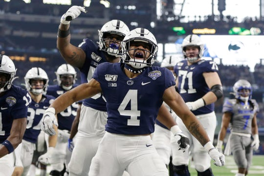 Penn State running back Journey Brown celebrates scoring a touchdown against Memphis during the first quarter of the Cotton Bowl at AT&T Stadium.