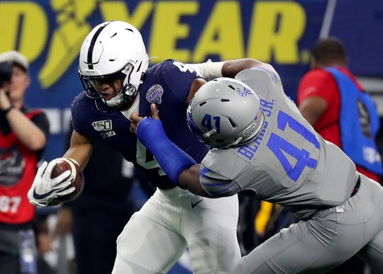 Dec 28, 2019; Arlington, Texas, USA;  Penn State Nittany Lions running back Journey Brown (4) runs past Memphis Tigers defensive back Sanchez Blake Jr. (41) to score a touchdown during the first quarter at AT&T Stadium. Mandatory Credit: Kevin Jairaj-USA TODAY Sports