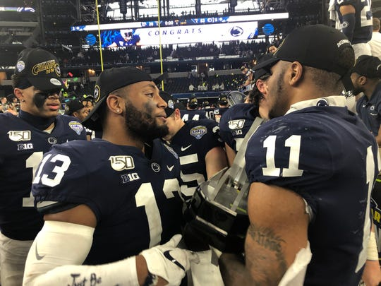 Penn State linebacker Ellis Brooks (13) shares a postgame Cotton Bowl moment with defensive MVP Micah Parsons (11).