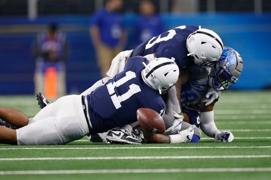 Dec 28, 2019; Arlington, Texas, USA; Memphis Tigers tight end Tyce Daniel (88) fumbles the ball after being hit by Penn State Nittany Lions linebacker Micah Parsons (11) and linebacker Ellis Brooks (13) in the second quarter at AT&T Stadium. Mandatory Credit: Tim Heitman-USA TODAY Sports