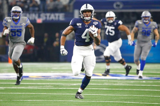 Penn State running back Journey Brown (4) carries the ball to the end zone for a touchdown against Memphis in the first half of the NCAA Cotton Bowl college football game, Saturday, Dec. 28, 2019, in Arlington, Texas. (AP Photo/Ron Jenkins)