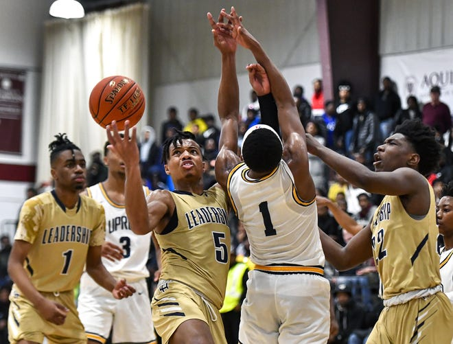 Leadership Academy's Maurice McKinney (5) reaches a a loose ball behind University Prep's Na'Zea Fowlks (1) during the Mike Dianetti Classic at Aquinas Institute, Friday, Dec. 27, 2019. Leadership Academy beat University Prep 80-78 in overtime.