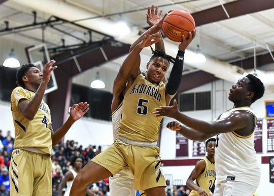 Leadership Academy's Maurice McKinney (5) grabs a rebound against University Prep during a game earlier this season. McKinney is averaging 22.2 points and 6.4 assists for the Lions (14-2) this season.