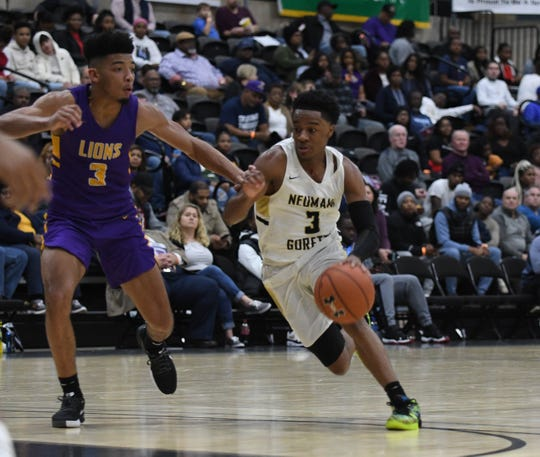 Neumann-Goretti's Hakim Byrd drives towards the basket against Legacy during the 39th Annual Governors Challenge held at the Wicomico Youth and Civic Center on Friday, December 27, 2019.