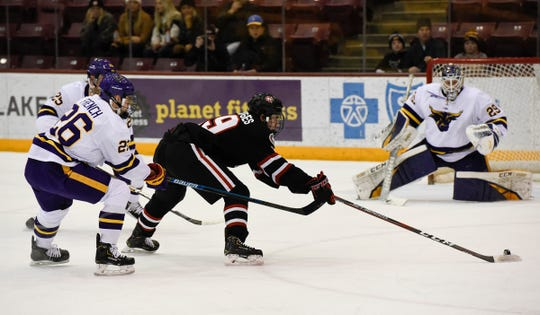 St. Cloud State sophomore Sam Hentges reaches for the puck  against MSU-Mankato Saturday, Dec. 28, 2019, at Mariucci Arena.