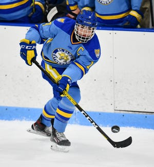 Cathedral's Mack Motzko advances with the puck during the first period of the Friday, Dec. 27, 2019, Granite City Hockey Showcase game at the MAC in St. Cloud.