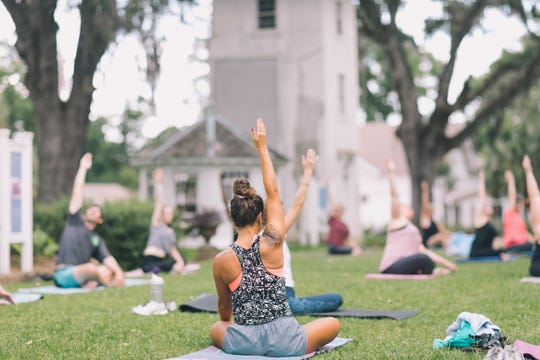 Premier Fitness leads a Training Tuesdays yoga class at Goodwood Museum.