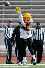 ASU's A.J. Carter runs a drill during practice before the Tony the Tiger Sun Bowl Saturday, Dec. 28, at the SISD Student Activities Complex in El Paso.