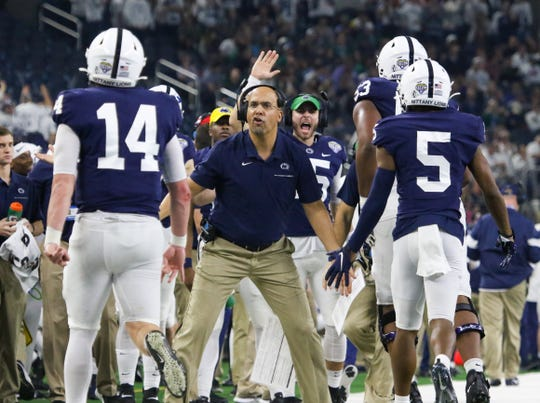 Penn State head football coach James Franklin celebrates his team's score against Memphis Saturday, Dec. 28, 2019, in the 84th Goodyear Cotton Bowl Classic in AT&T Stadium in Arlington. Penn State defeated Memphis 53-39.
