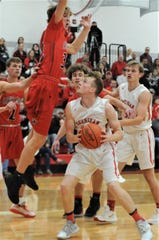 Sheridan's Landen Russell looks to go up for a shot against Fairfield Union's Andrew Moll on Friday night. The Falcons won 52-48.