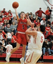 Fairfield Union's Ryan Magill puts up a a shot against a Sheridan defender on Friday night. The Falcons won 52-48.