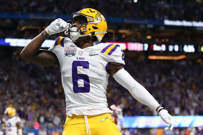 LSU Tigers wide receiver Terrace Marshall Jr. celebrates after scoring a touchdown during the first quarter of the Peach Bowl.