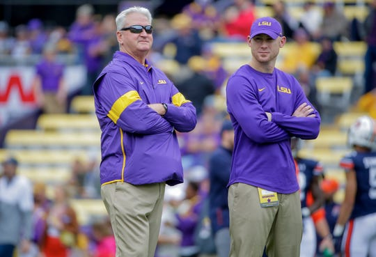 LSU offensive coordinator Steve Ensminger, left, stands with passing game coordinator Joe Brady during warmups before the team's game against Auburn.